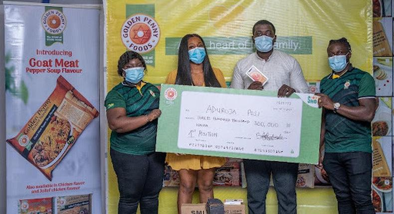 L-R; Digital Brand Manager, Omoefe Ohworakpo, Ex BBN Housemate, Lucy Edet Essien, Winner, Aduroja Posi and Marketing Activity Manager, Babatunde Adenaike at the gift presentation to the winners of the Golden Penny Shoot Your Shot competition in Lagos.