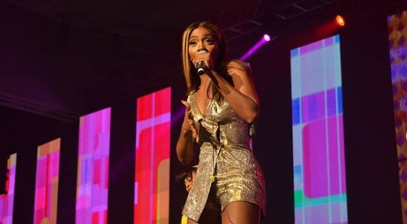 Who is Tiwa Savage talking to on Kizz Daniel's #Fvckyoucover?