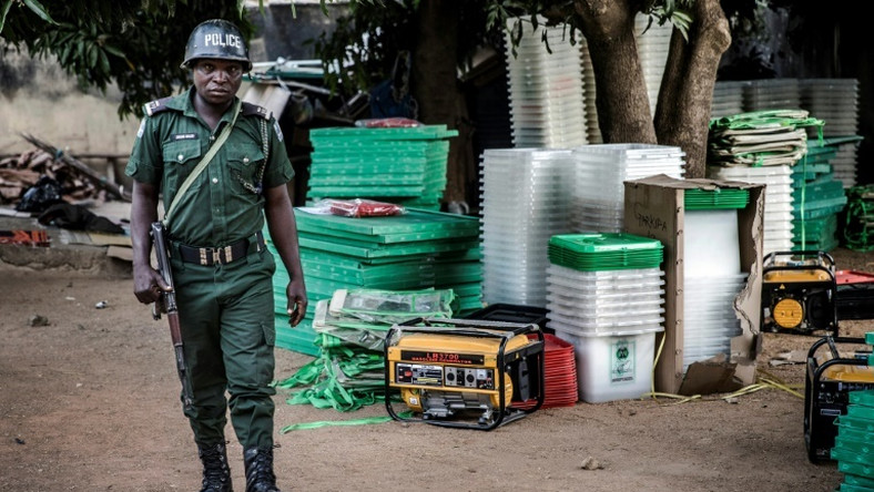 A police officer securing Nigeria's electoral materials (AFP)