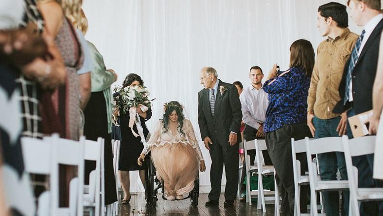 Paralysed bride surprises her guests by walking down the aisle