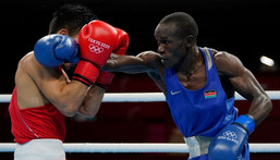Kenya's Nicholas Okongo Okoth and Mongolia's Tsendbaatar Erdenebat fight during their men's feather (52-57kg) preliminaries boxing match during the Tokyo 2020 Olympic Games at the Kokugikan Arena in Tokyo on July 24, 2021. (Photo by Frank Franklin II / POOL / AFP) (Photo by FRANK FRANKLIN II/POOL/AFP via Getty Images)