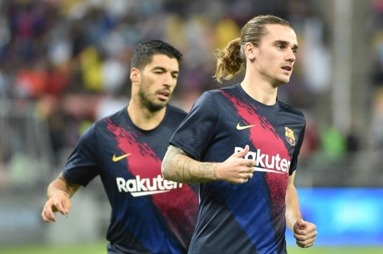 Antoine Griezmann (R) will have a key role to play for Barcelona in the coming months with Luis Suarez out injured