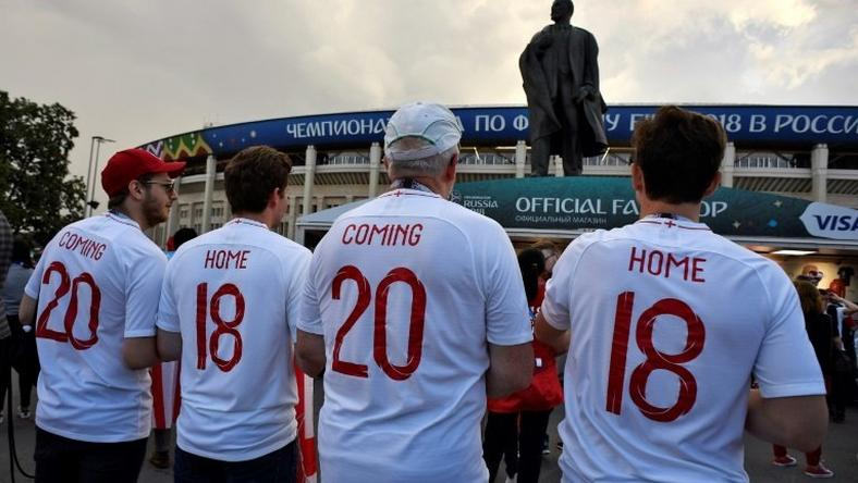 "British football song ""Three Lions"" contains the famous verse ""football's coming home"" (here on fans' jerseys at the 2018 Russia World Cup)and is now topping UK charts"