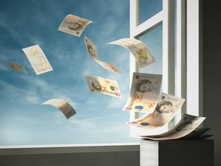 Paper currency blowing out of open window
