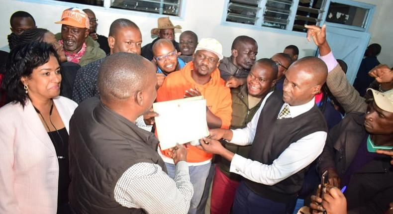 Imran Okoth receiving the ODM nomination certificate