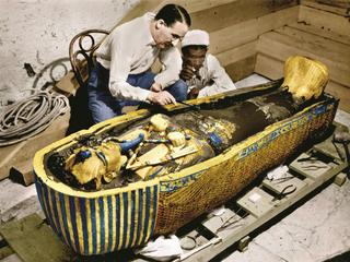 Howard Carter (1873-1939) english egyptologist near golden sarcophagus of Tutankhamon (mummy) in Egy
