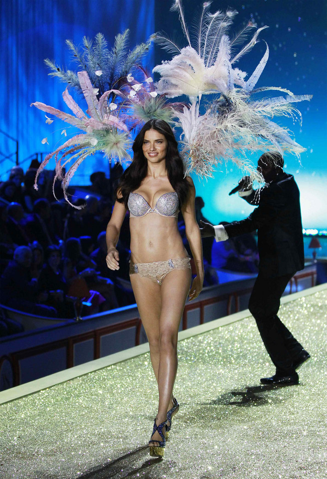 Model Adriana Lima presents the Bombshell Fantasy Bra designed by Damiani Jewellers during the Victoria's Secret Fashion Show at the Lexington Armory in New York