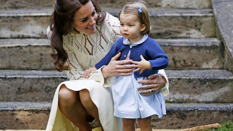 Britain's Catherine, Duchess of Cambridge, speaks to Princess Charlotte as they arrive at a children's party at Government House in Victoria