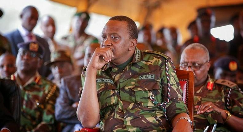 President Uhuru in a full Military gear with top Military Leadership
