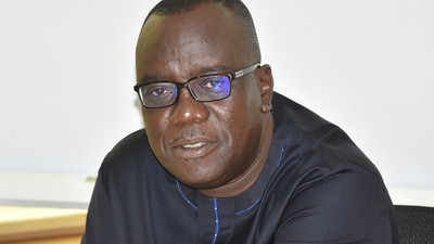 Ghanaians react to video of Sir John's body flown in a helicopter to his hometown for burial