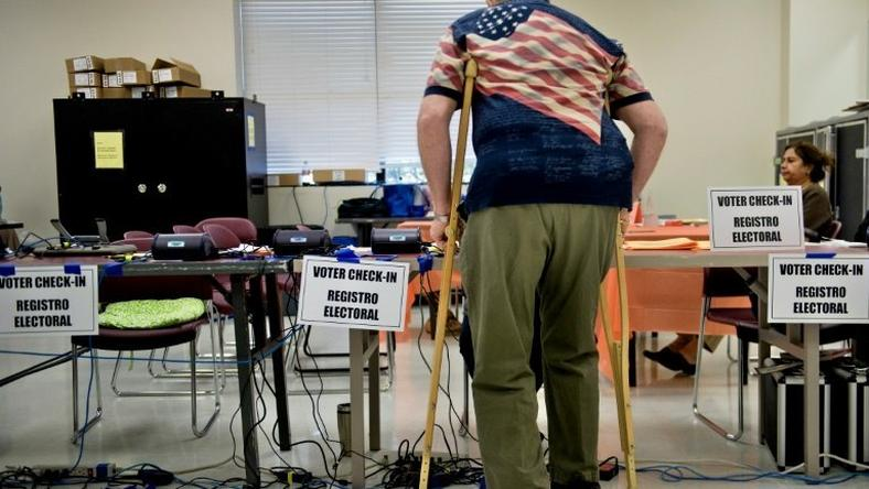 A man checks-in at the Activity Center at Bohrer Park during early voting on October 28, 2016 in Gaithersburg, Maryland