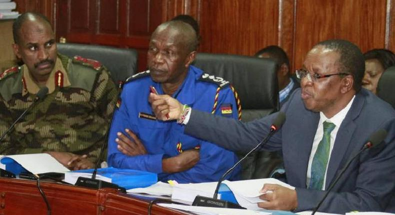 APS DIG Noor Gabow (L), KPS DIG Edward Mbugua (C) and Interior PS Karanja Kibicho (R). 23,900 APs have been ordered to return jungle green uniforms as the officers are transfered to Kenya Police Service