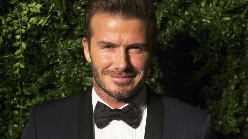 Former British soccer player Beckham smiles at the Evening Standard Theatre awards in London
