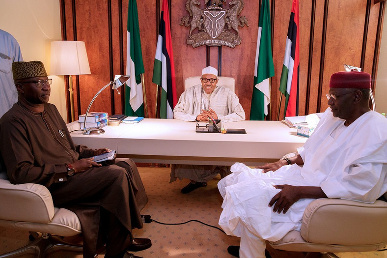 President Muhammadu Buhari with Secretary to the Government of the Federation (SGF), Boss Mustapha (left), and Chief of Staff, Abba Kyari (right), at the Presidential Villa