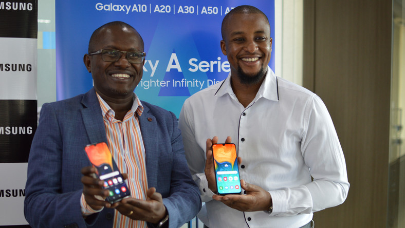 Samsung Electronics East Africa Head  of Internet and Mobile department Charles Kimari (left) and Ryan Mule, Product Marketing Manager (right) during the launch of the galaxy A series phone.