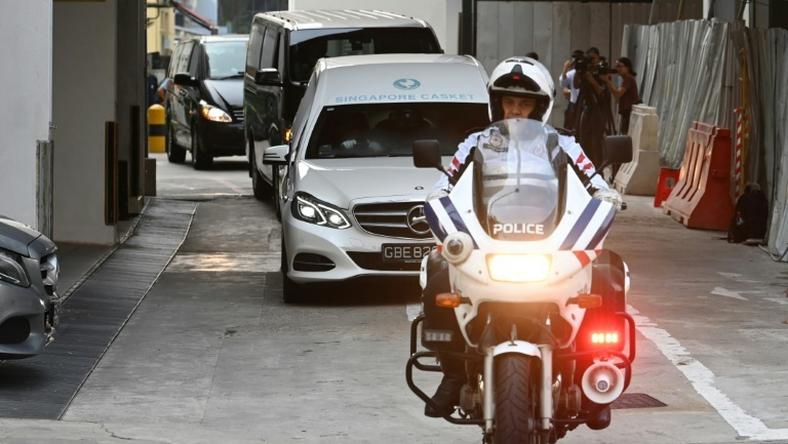 A hearse transporting Mugabe's body left a Singapore funeral parlour accompanied by a police escort