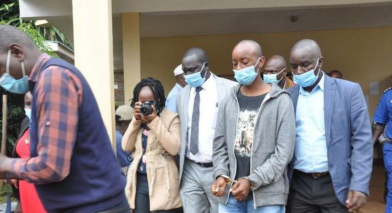 Lawrence Warunge Njoroge being led out of court following a past hearing