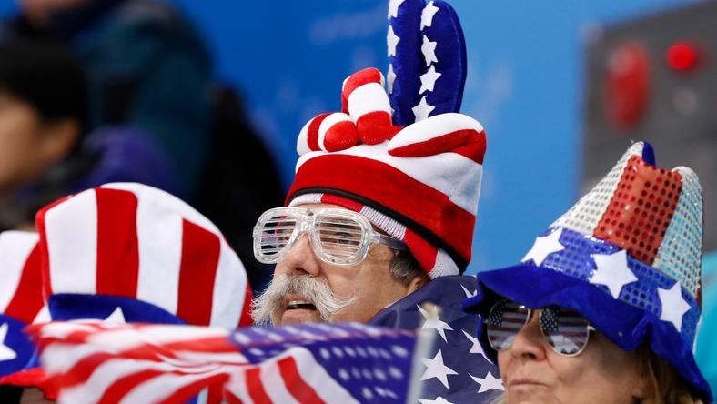 Fans look on during women's preliminary ice hockey action.