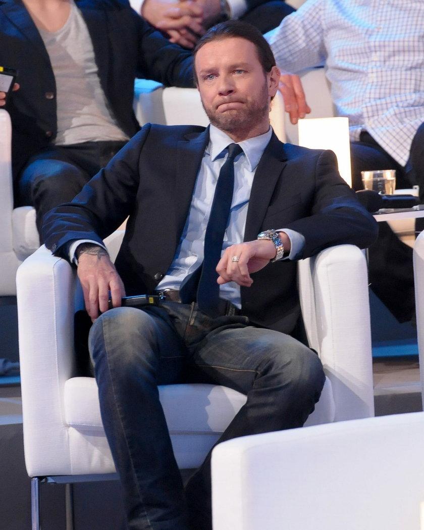 Radosław Majdan w garniturze