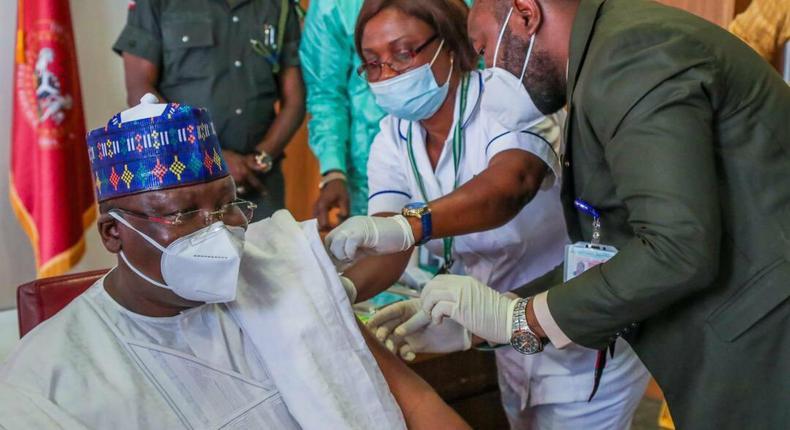 Senate President Ahmad Lawan receives first jab of Oxford-AstraZeneca COVID-19 vaccine. [Tope Brown]