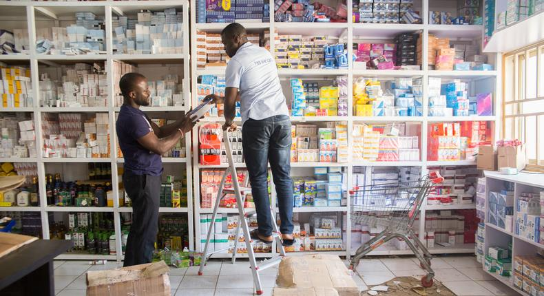 A staff at Supplier Warehouse in Abuja sorting products (Field Intelligence)