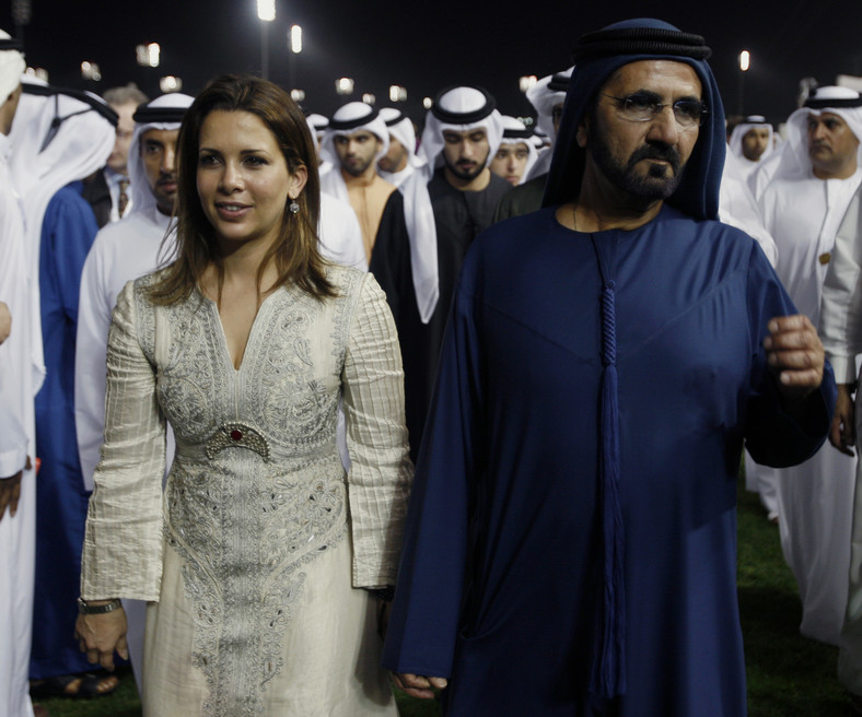Vice President and Prime Minister of the UAE and Dubai's ruler, Sheikh Mohammed bin Rashid al-Maktoum walks with his wife Jordanian Princess Haya bint Hussein after the eighth and final race of the 16th Dubai World Cup at the Meydan Racecourse in Dubai March 26, 2011.
