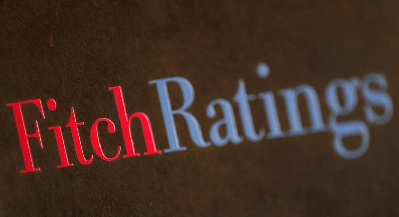 A plaque is pictured at the entrance of the Fitch offices in downtown Milan January 24, 2012.  REUTERS/Alessandro Garofalo