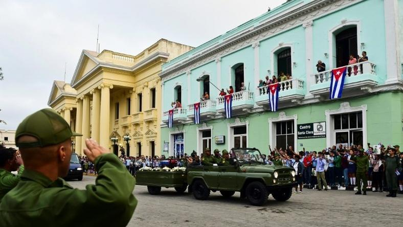 The urn with the ashes of Cuban leader Fidel Castro is driven through Santa Clara, Cuba, on December 1, 2016 during its four-day journey across the island for the burial in Santiago de Cuba
