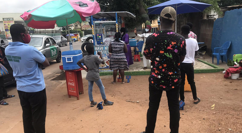 Waakye seller checking her customers to observe social distance goes viral, a lifestyle food vendors must adopt