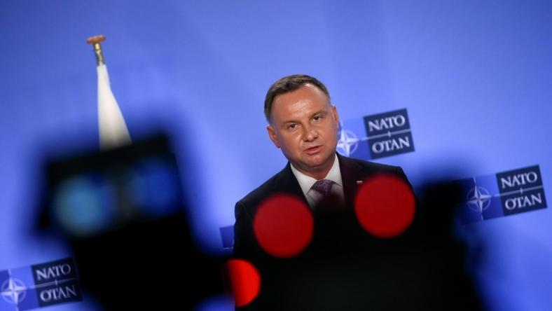 Polish President Andrzej Duda, seen speaking at a NATO conference in June, has pushed strongly for a permanent US military presence in his country