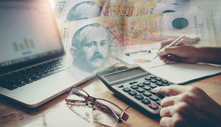 ekonomija dinari laptop porez foto RAS Shutterstock Oliver Bunic