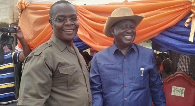 Funyula MP Paul Otuoma with ODM leader Raila Odinga.