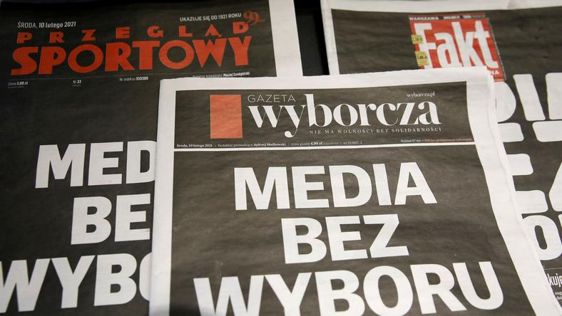 The first pages of Poland's main private newspapers have black front pages with the slogan 'Media wi