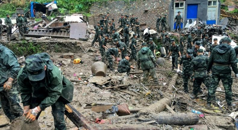 Search and rescue teams are trying to find more than a dozen people still missing after the typhoon struck Wenling city in eastern China