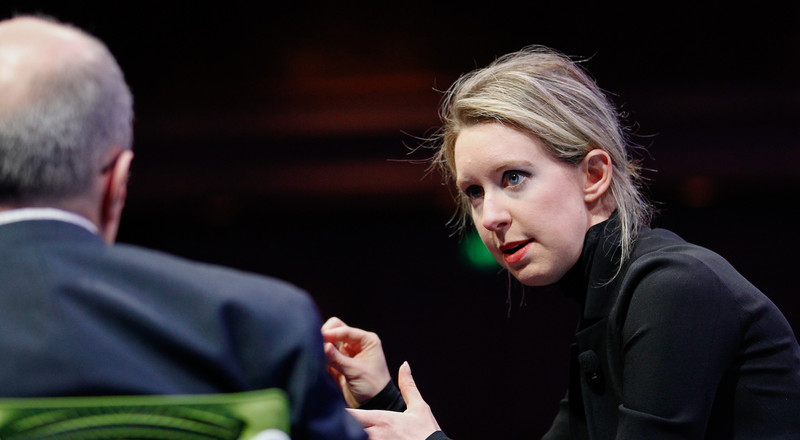 Elizabeth Holmes' defense lawyers are asking their work in the Theranos fraud case be deemed 'essential' so they can defy lockdown orders
