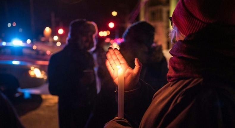 People come to show their support for the victims after an attack at a mosque in the Québec City Islamic cultural center on January 29, 2017
