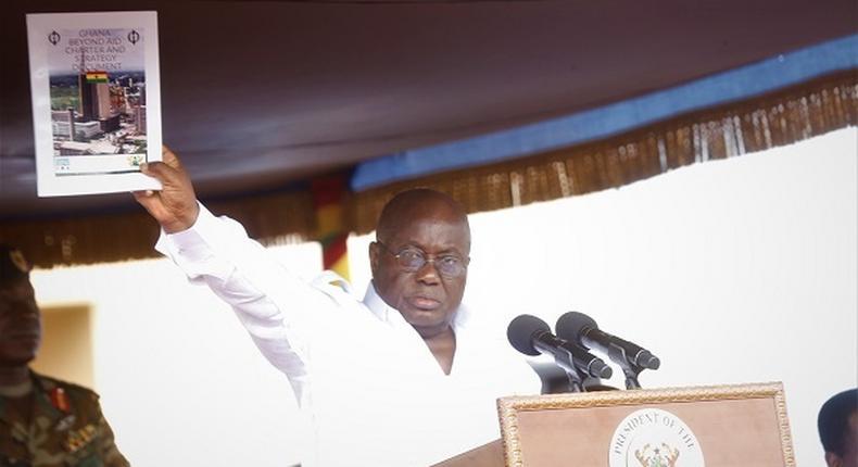 President Nana Addo Dankwa Akufo-Addo displaying the Ghana Beyond Aid document at the May Day celebrations in Accra