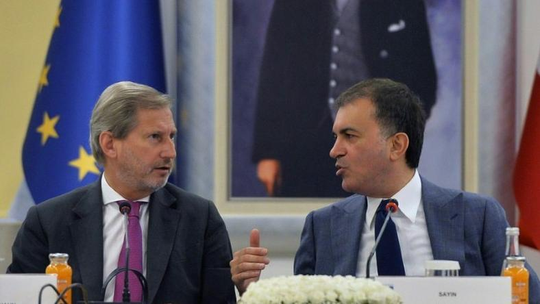 "Turkish EU affairs minister, Omer Celik, seen with EU enlargement commissioner Johannes Hahn, blasted EU lawmakers' vote to freeze accession talks as ""a politically motivated decision"" which was ""sabotaging relations"""