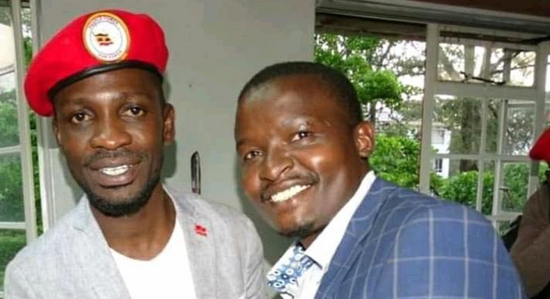 File image of Samwel Ragira (R) with Ugandan MP Bobi Wine