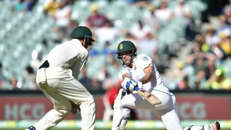 South Africa's Stephen Cook (R) hits a ball past Australia's captain Steve Smith on the third day of the third Test against Australia at the Adelaide Oval in Adelaide on November 26, 2016