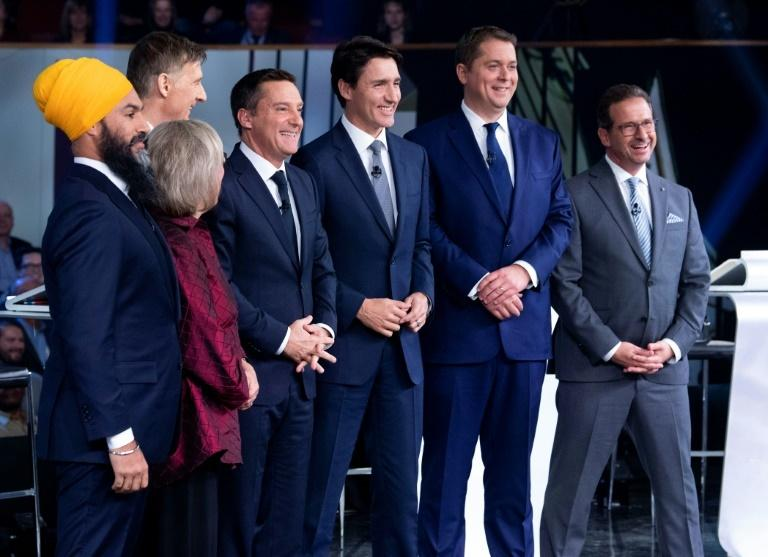 Canadian voters will choose between party leaders, pictured here on October 10.