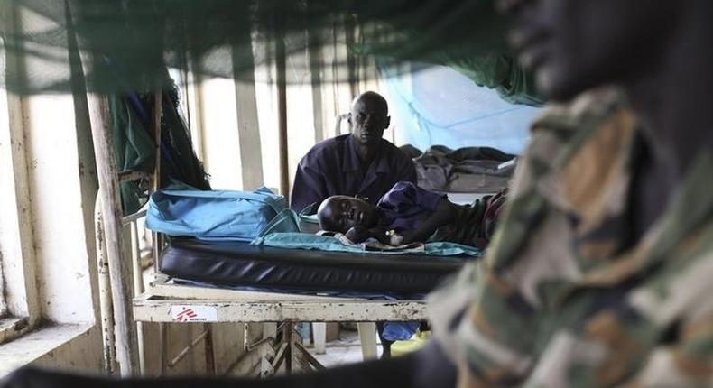 A child sick with malaria and from malnutrition lies on a bed in a hospital in Bor March 15, 2014. REUTERS/Andreea Campeanu
