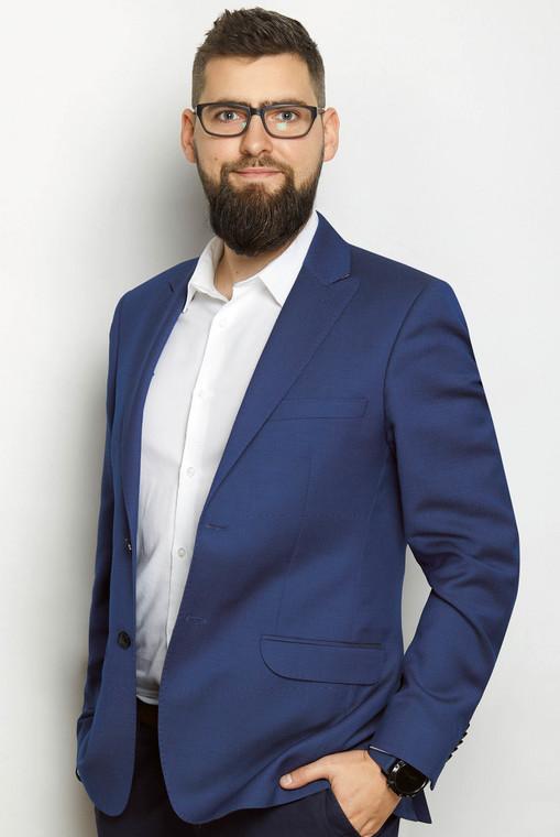 Mateusz Włoch z firmy Inelo, producenta oprogramowania i elektroniki do analizy i rozliczania czasu pracy kierowców  fot. Materiały prasowe