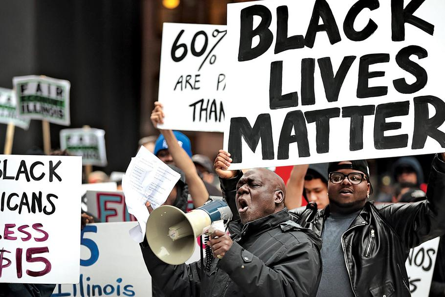 Black Lives Matter Protesters Join Living Wage Activists For Rally And March In Chicago