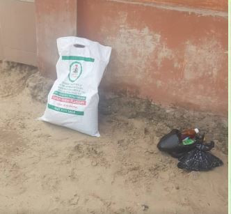 A bag of palliatives found in the school premises when no parent was in sight to receive the food items on behalf of their children. (Pulse)