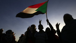 """[FILE] Sudanese women march in Khartoum to mark International Day for Eliminating Violence against Women, in the first such rally held in the northeast African country in decades, on November 25, 2019. - Chanting """"Freedom, peace, justice,"""" the catchcry of the protest movement that led to autocrat Omar al-Bashir's ouster in April, the demonstrators took to the streets in the Burri district, a site of regular anti-Bashir protests earlier this year. (Photo by Ashraf SHAZLY / AFP) (Photo by ASHRAF SHAZLY/AFP via Getty Images)"""