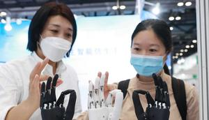A staff member introduces intelligent bionic hands at the Care And Rehabilitation Expo China 2021 on Beijing, China.
