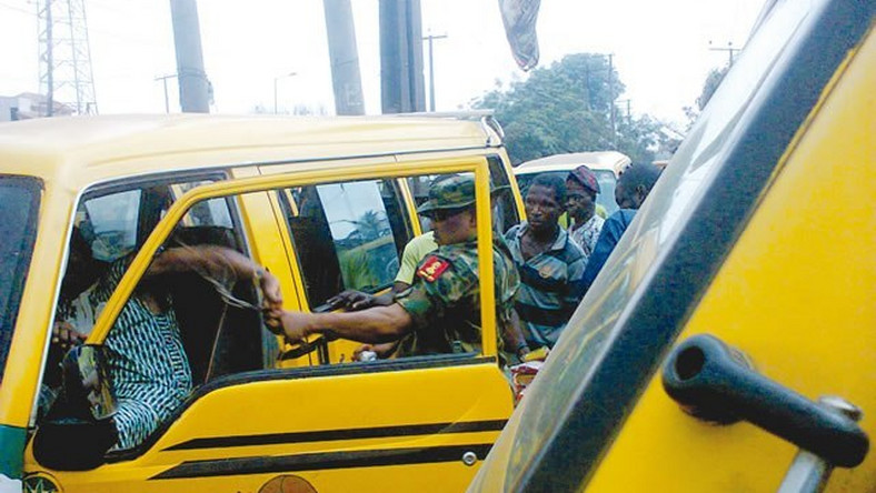 The soldier brutalising the bus driver