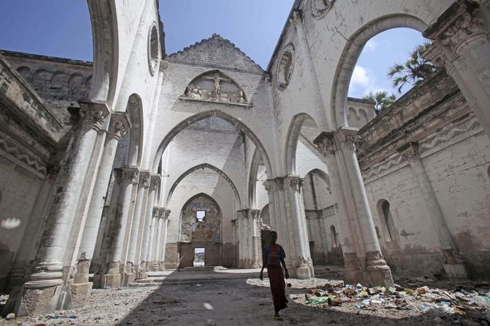 A boy stands inside a destroyed church in the Hamerweyne district of Mogadishu September 26, 2013. S