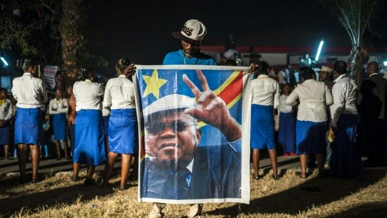 A supporter of the Democratic Republic of Congo's opposition leader Etienne Tshiskedi holds his portrait during a rally in Kinshasa, in July 2016
